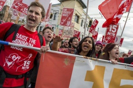 Marching for a 15 dollar minimum wage. Seattle, April 2014.  Photo from 15 Now/Seattle.