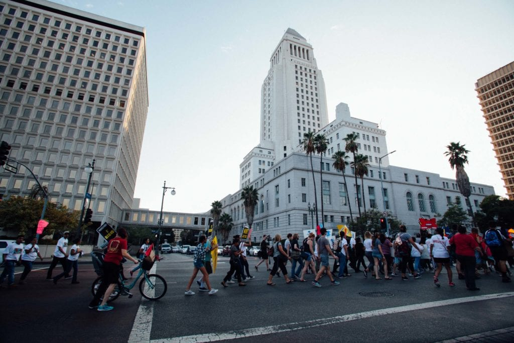 Hundreds march up Temple St. in downtown Los Angeles towards City Hall to protest President Trump's decision to rescind DACA.