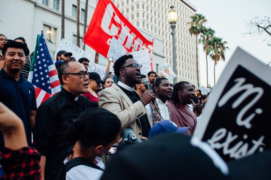 Clergymen from the African-American and Asian-American communities speak at the rally at City Hall in downtown Los Angeles.