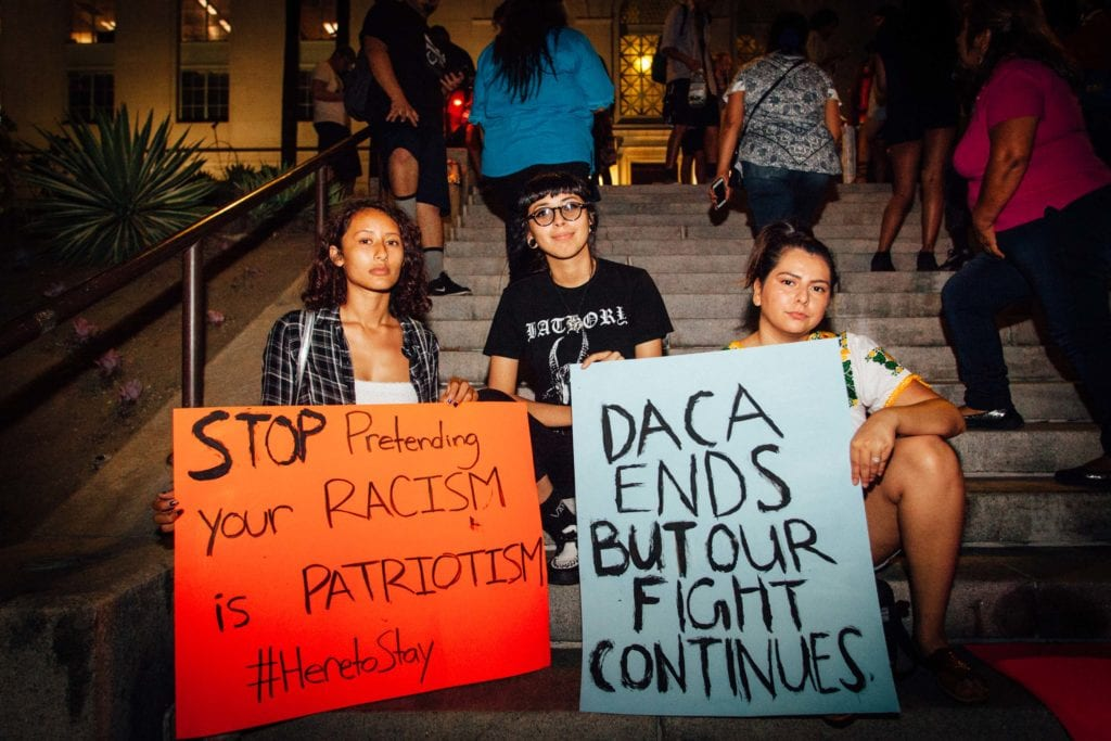 Celestina Mendoza (left) and Margarita Hurtado (right) protest in support of their friend Areli Chairez (middle) who is a DACA recipient and student at L.A. Valley College.