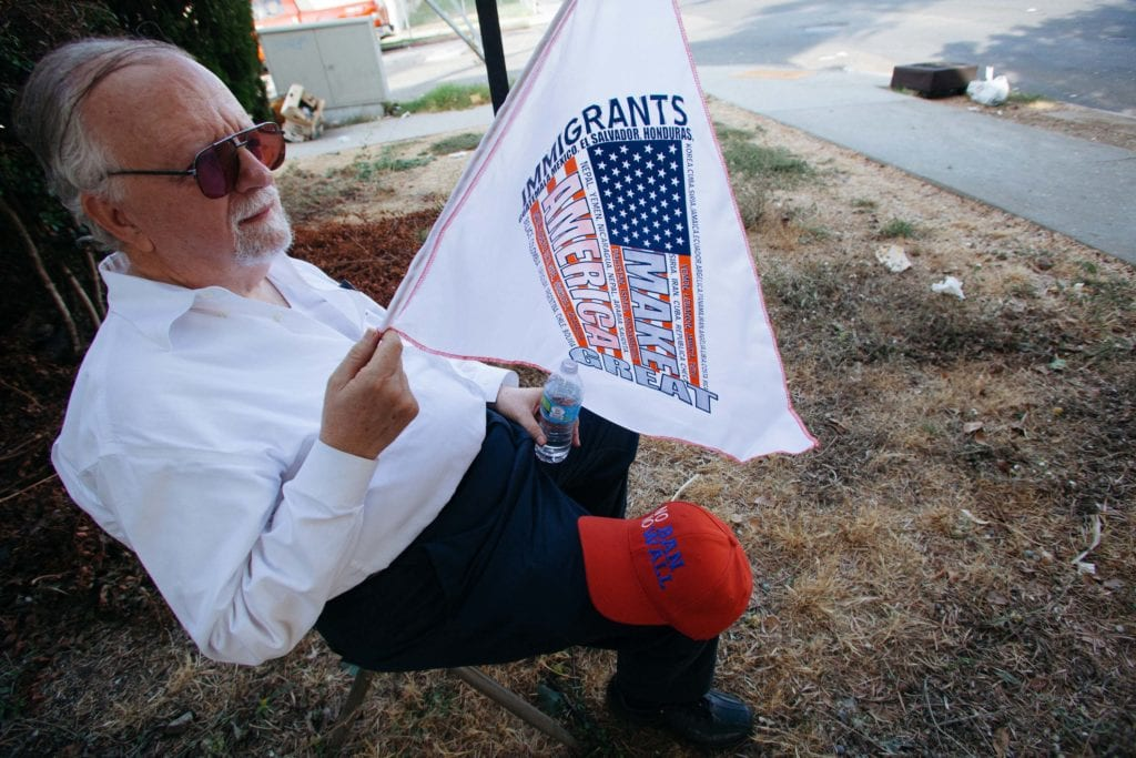 Michael Ross traveled from Upload, CA to attend the Defend DACA March in Los Angeles, CA. He couldn't physically walk any further and decided to sit on a chair he found on Bonnie Brae St. near MacArthur Park where the march began to cheer protestors on.