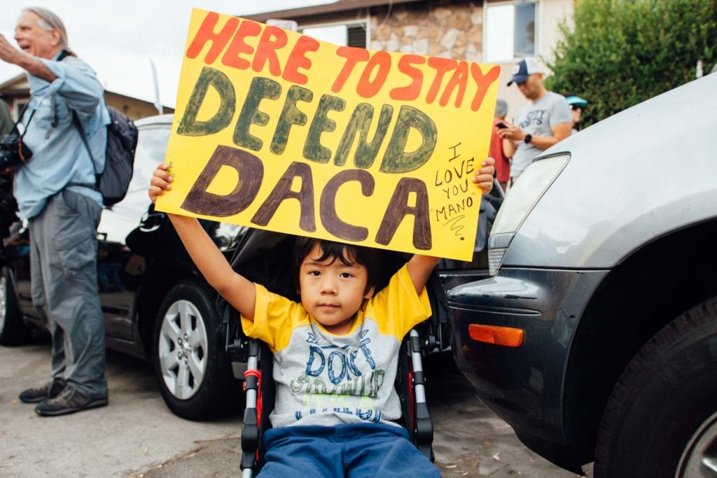A child protests at the Defend DACA March rally at Echo Park in Los Angeles, CA. Many families attended the march, even those with small children. People felt it was important to have entire families there in support of loved ones and their community.