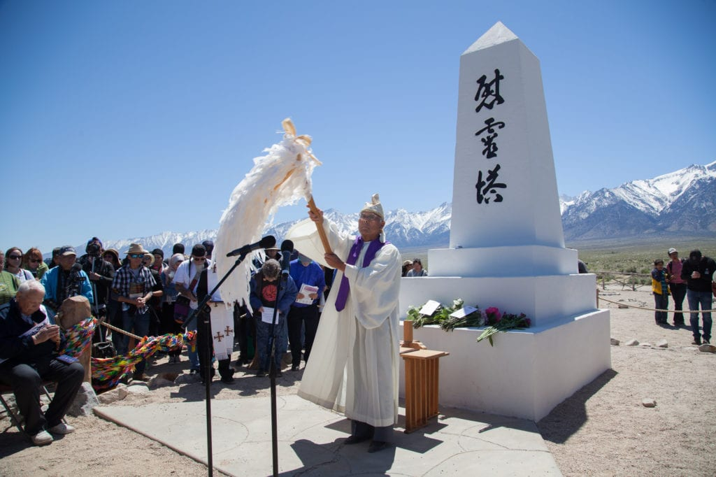 Rev. Alfred Yoshi Suyuki of the Konko Church leads a Shinto ceremony to begin the interfaith service at the I Rei To monument. Photo by Joanne Kim