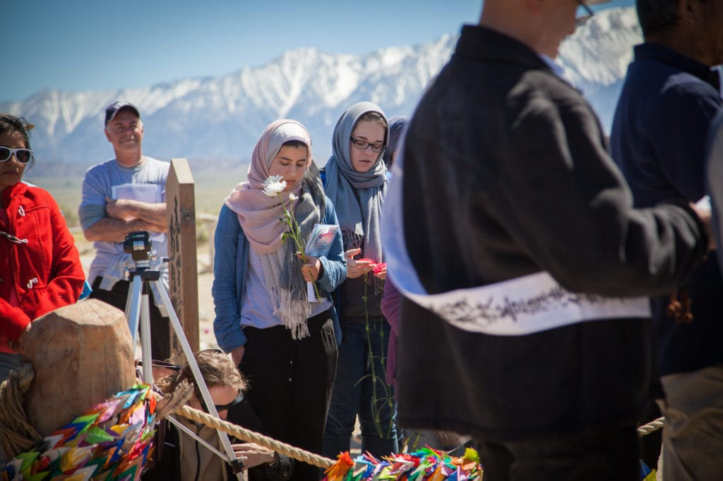Attendees pray with the Buddhist ministers during the interfaith service at the Manzanar Pilgrimage. Photo by Joanne Kim