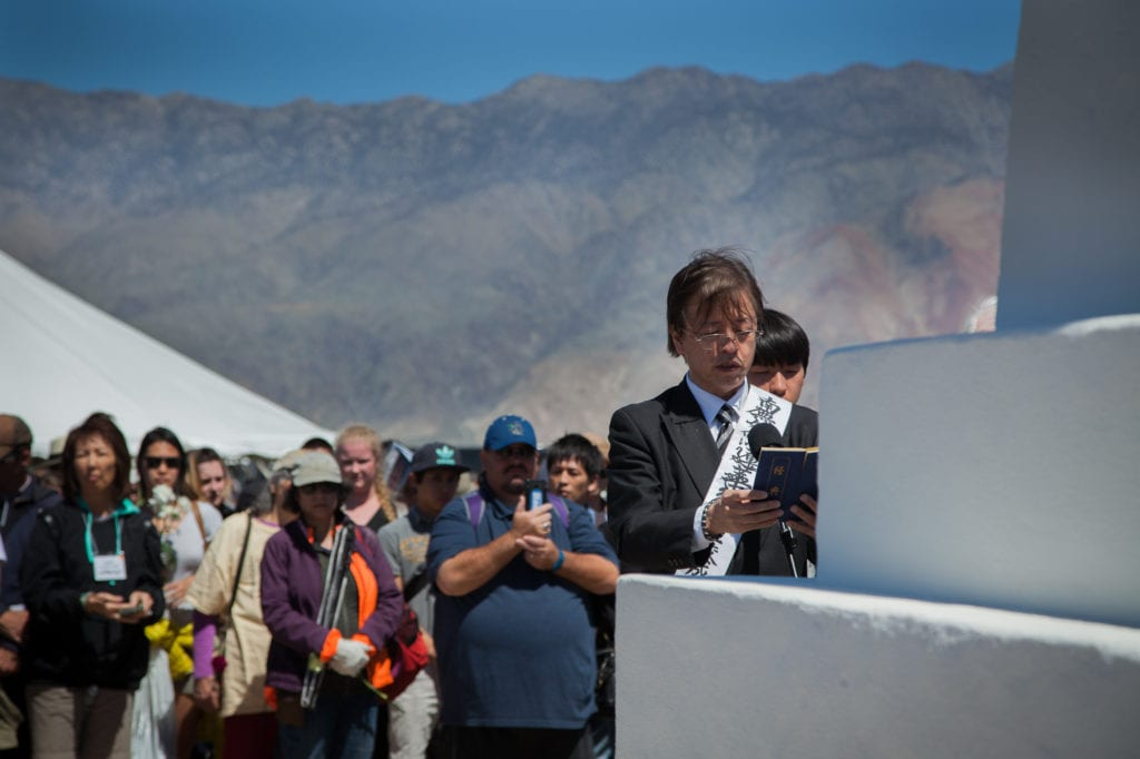 Buddhist minister reads a sutra as part of the interfaith service at the Manzanar Pilgrimage. Photo by Joanne Kim