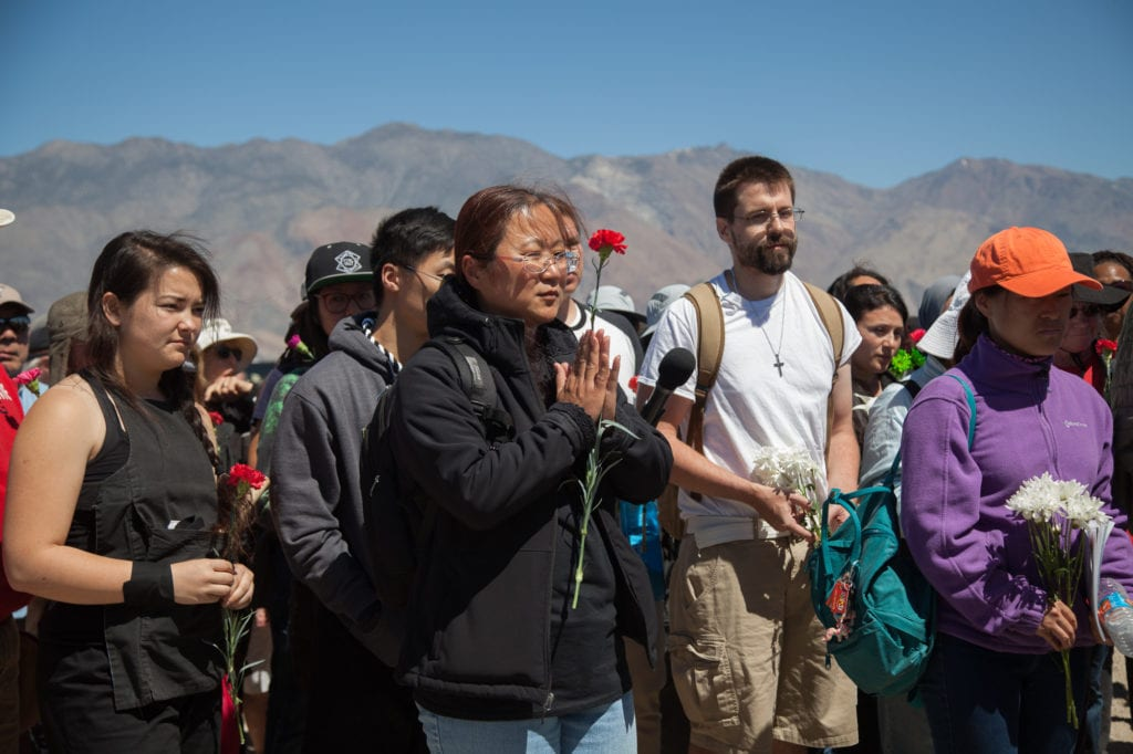 Attendees pay their respects to those who were interned at Manzanar. Photo by Joanne Kim
