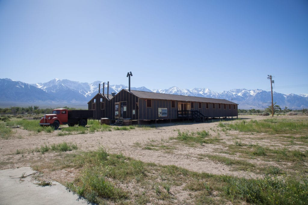 Recreation of the dining hall at the Manzanar camp located in a valley below the Eastern Sierras (background). Photo by Joanne Kim