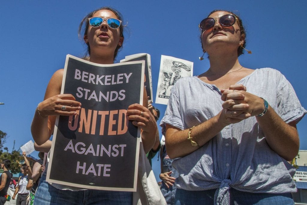BERKELEY, CA - 27AUGUST17 - Community organizations, leftwing and anti-racist groups, churches and religious leaders and others marched through the streets of Berkeley, carrying banners and blocking streets, to protest a planned rally by Nazis and white supremacists. Copyright David Bacon