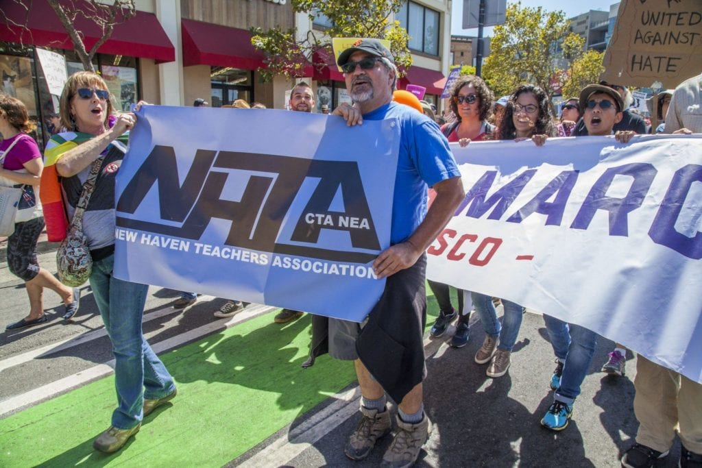 SAN FRANCISCO, CA - 26AUGUST17 - Community organizations and unions in San Francisco marched up Market Street, carrying banners and blocking streets, to protest a planned rally by Nazis and racists in San Francisco. Copyright David Bacon