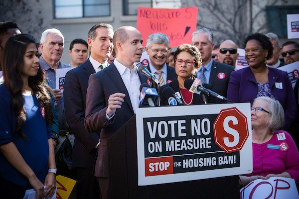 "Rusty Hicks speaks at the Casa Heiwa affordable housing complex in Little Tokyo. Photo via the ""No on S"" campaign."