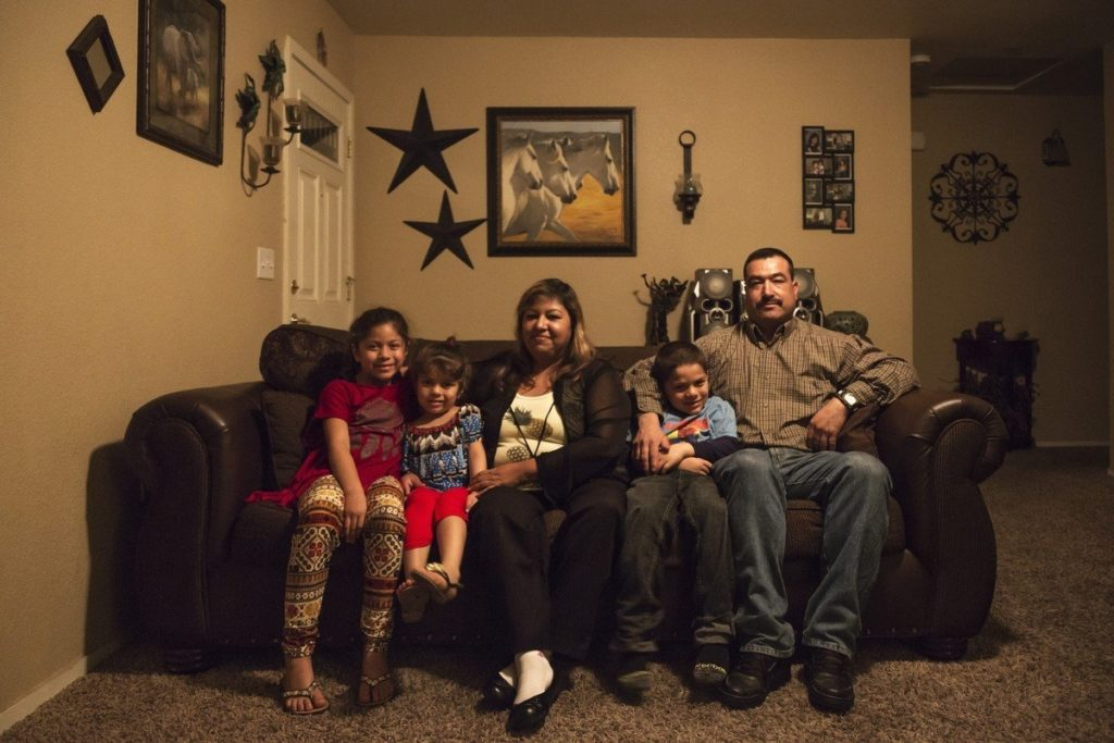 The Chavezes inside their Fresno home, which they helped build themselves.