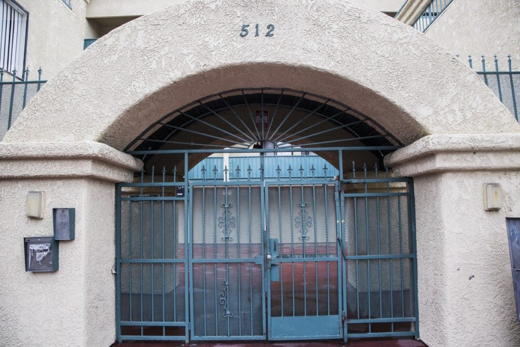 Outside of the Orantes' apartment building.