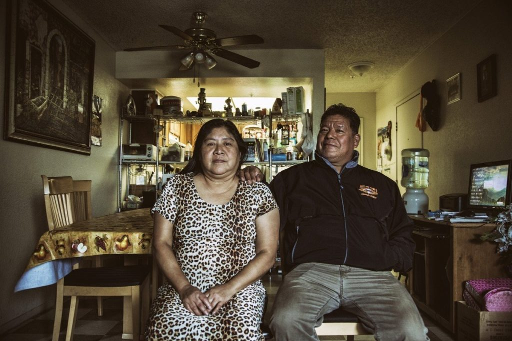 Amalia Orantes and her husband Enrique share a small two-bedroom apartment with four of their adult children in Santa Ana.