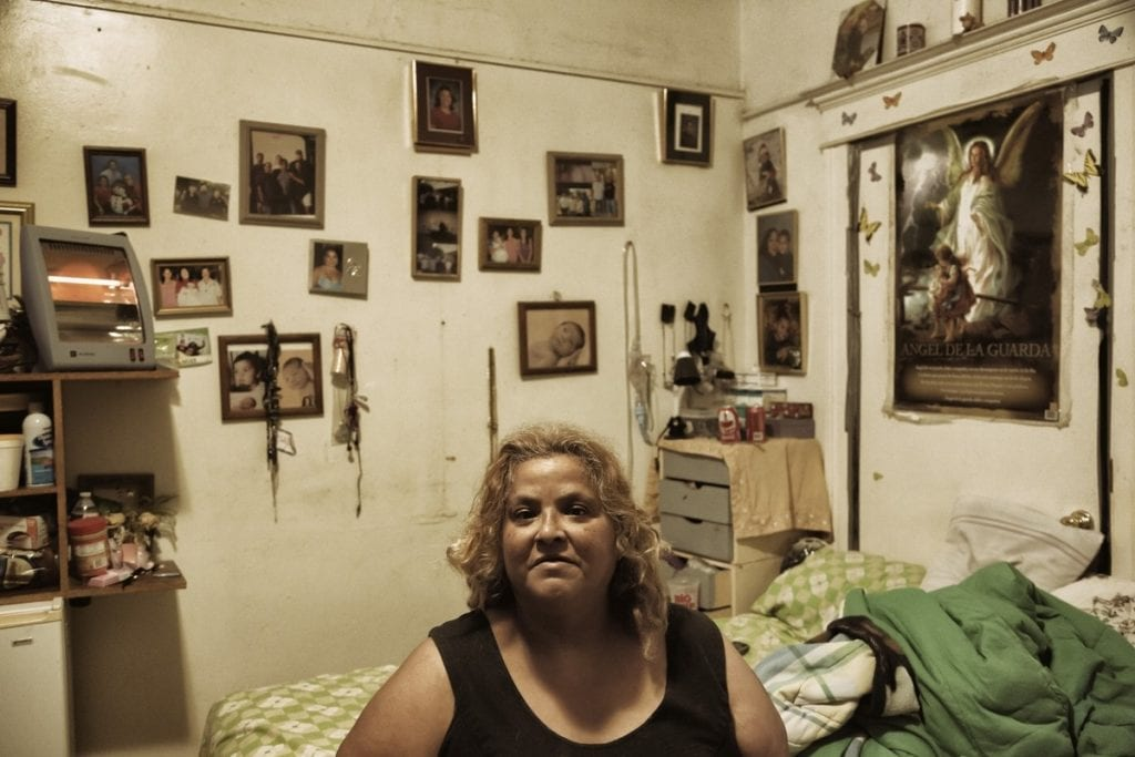 Isabelle Lopez inside her room rental. (Photo by Ted Soqui)
