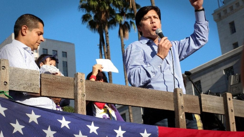 Senate President Pro Tem Kevin De León addressing December immigrant-rights rally. (Photo by Leighton Woodhouse)