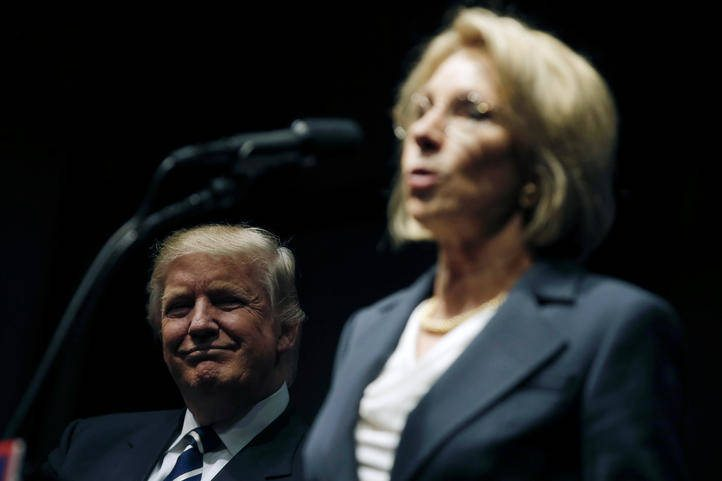"U.S. President-elect Donald Trump looks on as his choice for U.S. Education Secretary Betsy DeVos speaks at a ""Thank You USA"" tour rally in Grand Rapids, Michigan, U.S. December 9, 2016.  REUTERS/Mike Segar"