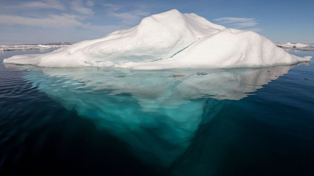 1200px-Iceberg_in_the_Arctic_with_its_underside_exposed