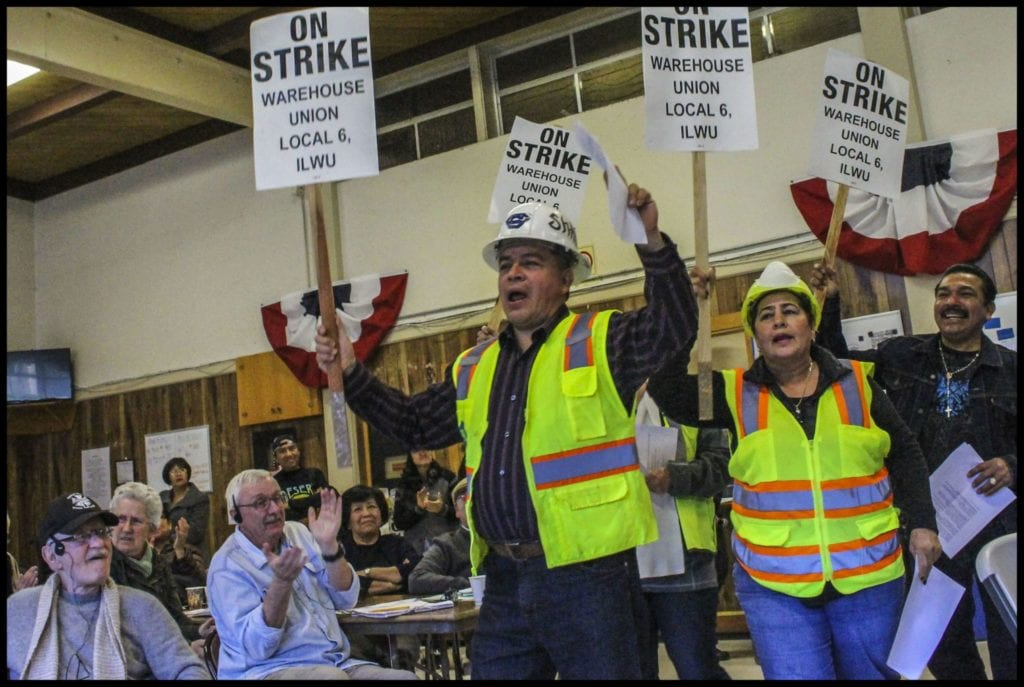 Workers re-enact a strike protesting immigration raids. (Photo: David Bacon)