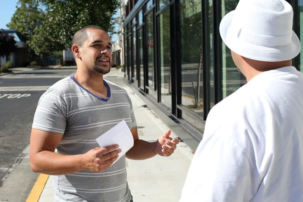 Richmond City Councilmember Melvin Willis, right, spreads the word about renters' rights.