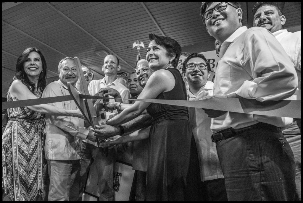 Electeds and labor veterans, including UFW president Arturo Rodriguez, second from left, cut exhibition ribbon. (All photos by David Bacon)