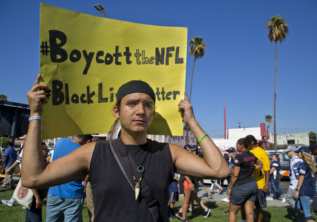 Native American actor named Courage, 28, at a protest in support of Colin Kaepernick outside the L.A. Coliseum