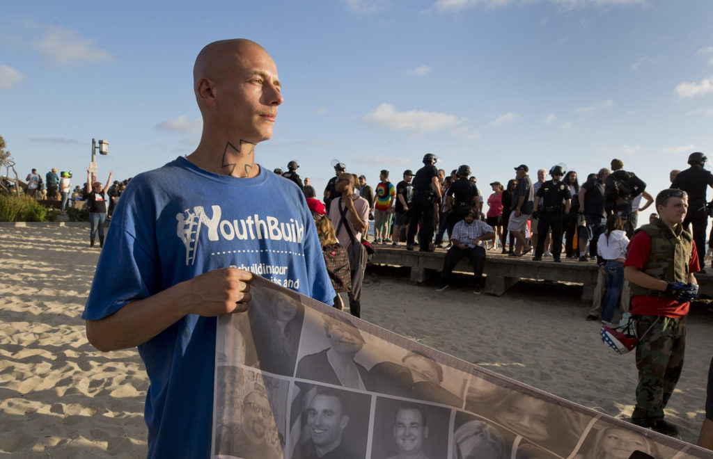 Tyler Denzin, 22, at a pro-Trump and anti-immigration demonstration at the Laguna Beach boardwalk.