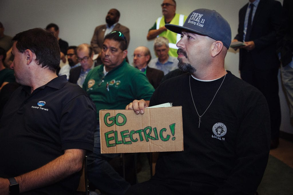 "Electrician Francisco ""Paco"" Arago attends a California Public Utilities Commission community meeting on electric transportation. Arago, a Boyle Heights resident, says he doesn't know how he will continue to raise his family in such a polluted area of the city. (Photos: Joanne Kim)"