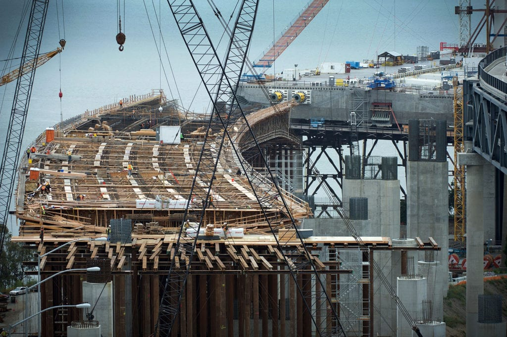 Construction laborers work on a section of the San Francisco-Bay Bridge in San Francisco, California, U.S., on Tuesday, July 12, 2011. (Photo: David Paul Morris/Bloomberg via Getty Images)