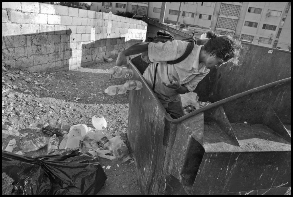 TIJUANA, BAJA CALIFORNIA NORTE, MEXICO - 9SEPTEMBER14 - Luisa, a homeless woman, collects cans and plastic from garbage dumpsters, near the Tijuana River, in downtown Tijuana, not far from the U.S. Mexico border. Copyright David Bacon