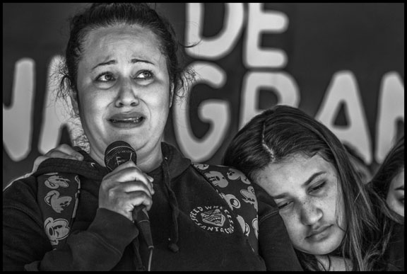 Lourdes and her Daughters at a Vigil Outisde the Richmond Immigrant Detention Center Where her Husband Fernando is Detained