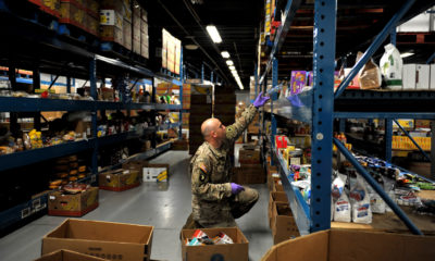 A U.S. Army National Guard Soldier, SSG Daniel Rasik, assigned to the Ohio National Guard's HHC 1-148th Infantry Regiment – 37th Infantry Brigade Combat Team, stocks shelves at the Toledo Northwestern Ohio Food Bank, March 23, 2020. Nearly 400 Ohio National Guard members were activated to provide humanitarian missions in support of COVID-19 relief efforts, continuing The Ohio National Guard's long history of supporting humanitarian efforts throughout Ohio and the nation. (Air National Guard photo by Senior Master Sgt. Beth Holliker)
