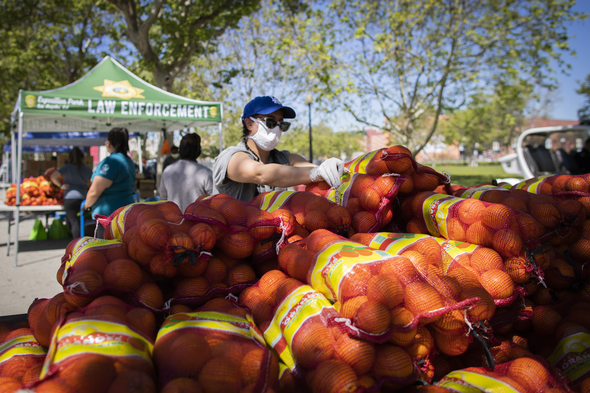 Elizabeth Bowman, Director of Farmers Market Operations for Sustainable Economic Enterprises of Los Angeles (SEE-LA) helps with the Farm Box Program.