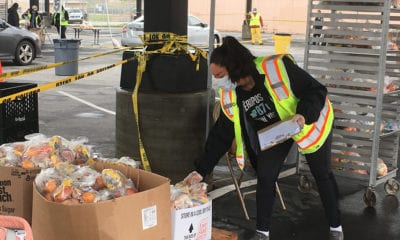 Worker at the Grab-and-Go center at the San Fernando High School in Pacoima