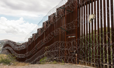 The US/Mexico border fence in Nogales, Arizona.