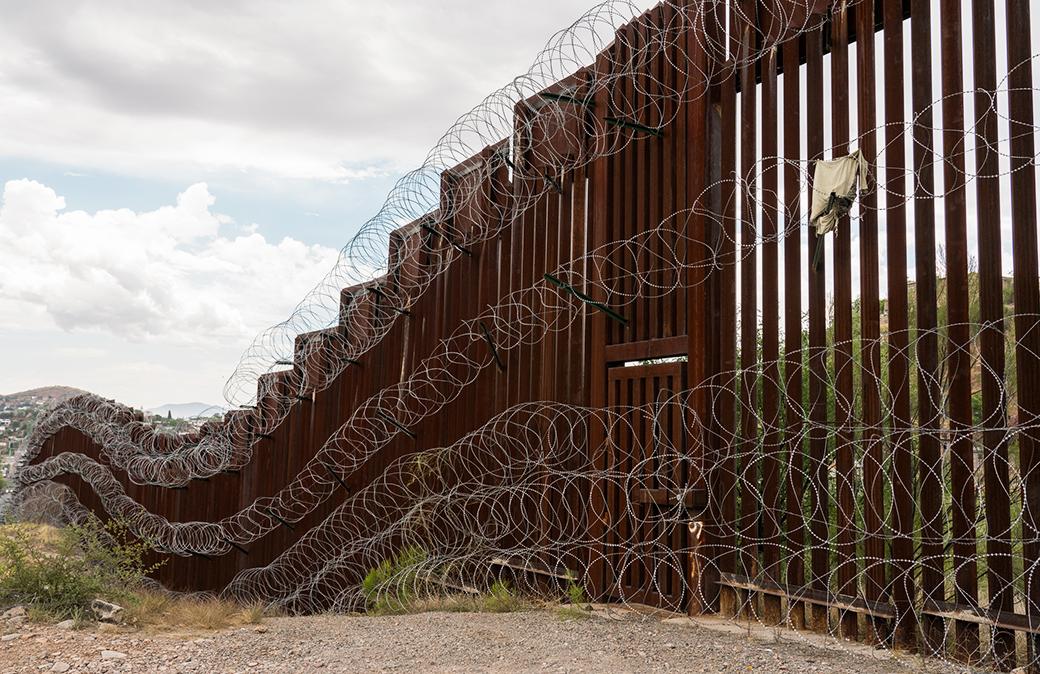 The US/Mexico border fence in Nogales, Arizona.