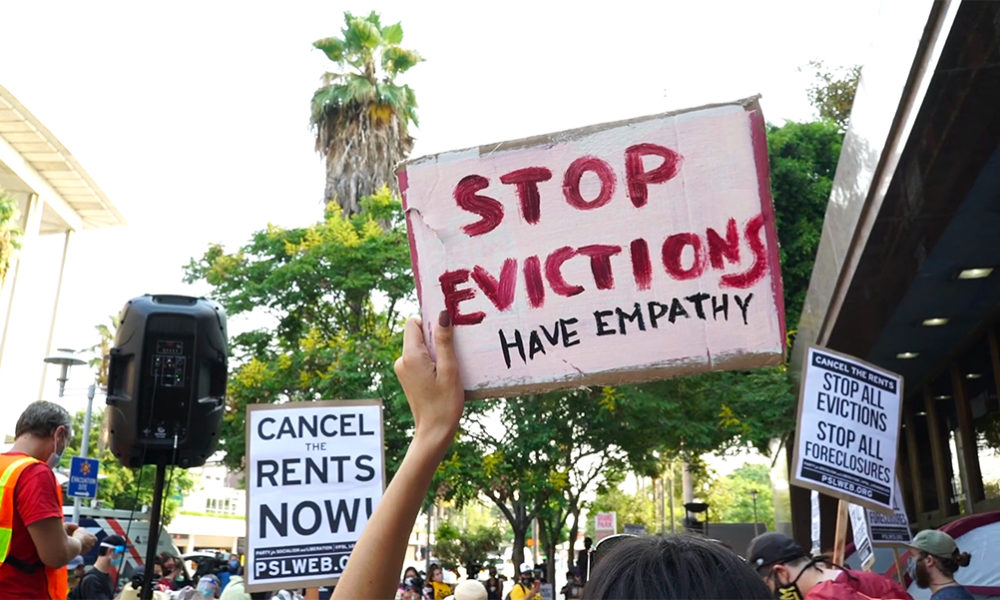 Protesters in downtown Los Angeles call for the cancellatioon of rent during the pandemic
