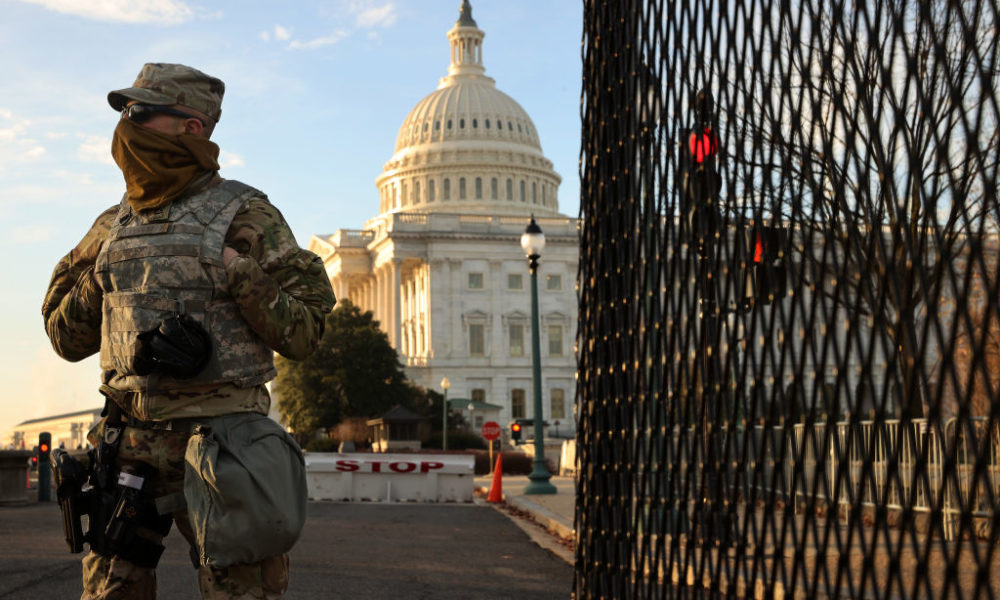 A member of the New York National Guard stands at a gate outside the U.S. Capitol the day after the House of Representatives voted to impeach President Donald Trump for the second time January 14, 2021 in Washington, DC.