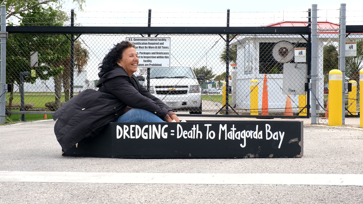 Diane Wilson protests outside the Army Corps of Engineers offices in Galveston on May 12. Photo by Dyar Dentz.